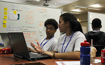 Two students participating in hackathon