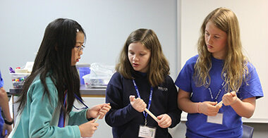 Three young students at STEM competition