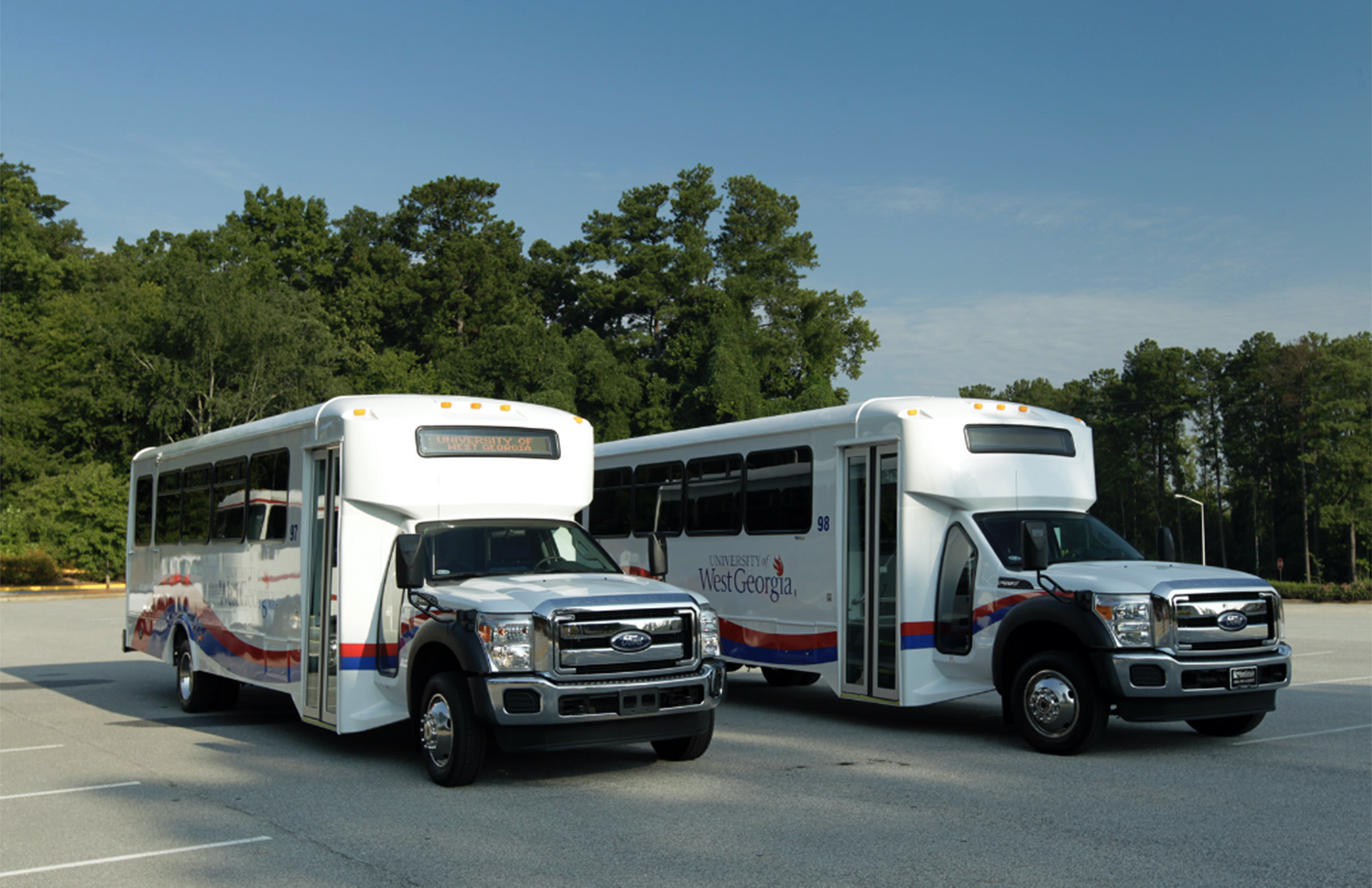 UWG buses parked on the street.