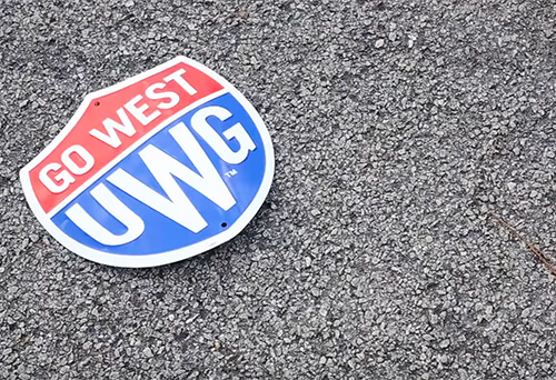 UWG Go West shield on pavement